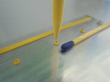 Dispensing thermal paste.