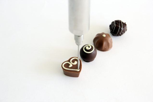 decorating chocolates with dosing pumps